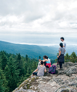 Family looking at a view from a mountain top