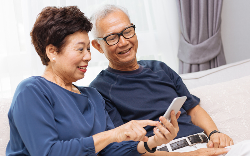 Retired Couple Using Retirement Planning Tools on Smart